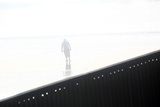 A Man Walks Near a Wall Separating Mexico and the United States in Tijuana