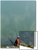 A Fisherman Casts His Line