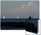 Amateur Angler Casts His Fishing Rod as Yachts Sail by in Sliema