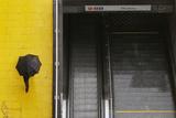 Commuter Walks Past Closed Metro Station