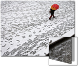 A Woman Walks across a Snow Covered Square in Madrid
