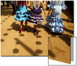 Women Wearing Typical Sevillana Outfits Walk During the Traditional Feria De Abril in Seville