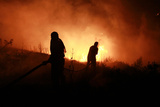 Residents and Civil Defence Crew Try to Put Out Flames During Forest Fire in Akkar
