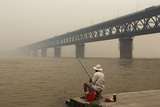 A Resident Fishes on the Bank of the Yangtze River