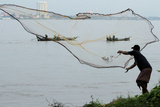 A Fisherman Casts His Net at the Mekong River in Phnom Penh