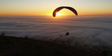 Paragliders Take in the Last of the Day's Light as a Seasonal Fog Engulfs Cape Town