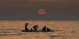 Palestinian Fishermen Fish at Sunset Off Gaza City