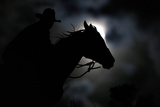 Wrangler Nate Cummins Takes the Opportunity to Ride by Moonlight
