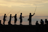A Fisherman Casts His Line from Havana's Seafront Boulevard El Malecon