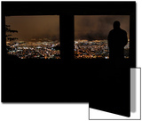 A Man Looks Out at the View of Tegucigalpa at Night