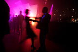 Revellers Dance at an Office Christmas Party in London