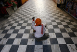 A Beggar Waits for Alms Outside a Hindu Temple in New Delhi