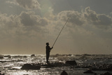 A Man Fishes Near the Seaport in Benghazi