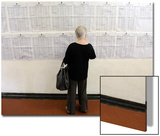 A Woman Checks a List of Places to Vote in Sao Paulo