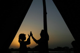 Girls  Who are Victims of the Floods Play Outside their Tent During Dusk
