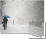 A Woman Shields Herself under an Umbrella as She Walks During a Heavy Snowfall