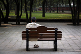 A Man Stretches as He Sits on a Bench at Ritan Park Located in Central Beijing
