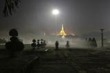 A Woman Exercises in a Public Park Near Shwedagon Pagoda in Yangon