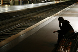 A Commuter Waits for His Train at the Lille-Flandres Station in Northern France