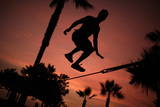 A Man Performs on the Slackline at a Park in Lima