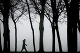 A Woman Walks Through Thick Fog in Leicester