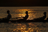Rowers are Silhouetted During Sunset on the Potomac River in Washington