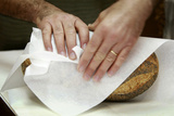 Baker Wraps a Loaf of Bread in Paper in His North Sydney Bakery