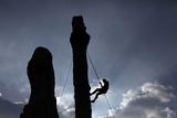 A Climber Reaches the Top of an Outdoor Climbing Wall in Berlin