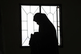 A Muslim Woman Is Silhouetted