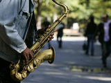 A Man Plays the Saxophone in New York's Central Park