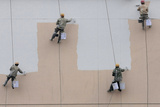Workers Paint the Exterior of an Unfinished Supermarket Building in Nanjing