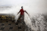 A Boy Is Hit by a Large Wave During High Tide at Mumbai's Seafront