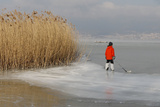 A Boy with Skates Stands on a Frozen Part of the Lake Neuchatel in Cudrefin
