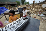 A Girl Plays on a Damaged Electronic Organ