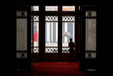 A Woman Looks Out at Tiananmen Square from Inside the Great Hall of the People in Beijing
