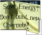 A Ukrainian Environmental Demonstrator Stands Behind a Banner