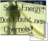A Ukrainian Environmental Demonstrator Stands Behind a Banner
