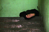 An Unemployed Man Sleeps at a Hallway in Panama City