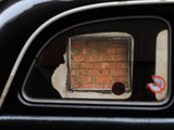 A Passenger Being Driven in a Taxi Passes a Bricked-Up Atm Machine Slot in the City of London