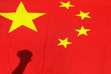 Shadow of Clenched Fist of Protester Is Seen on Chinese National Flag During Anti-Japan Protest