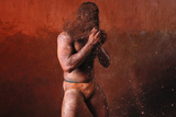 A Wrestler Rubs His Hands with Mud to Prevent Slipping Due to Sweat
