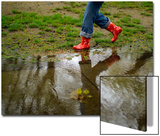 A Woman Wearing Rubber Boots Walks Near a Puddle in Boston  Massachusetts