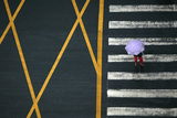 A Pedestrian Holding an Umbrella Walks across a Main Intersection on a Rainy Day in Chengdu
