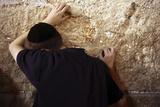 A Jewish Worshipper Prays at the Western Wall During Prayers Marking Tisha B'Av  in Jerusalem