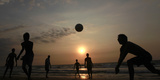 Youths Play Volleyball on the Beach in Colombo