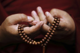 Prayer Beads are Seen as a Tibetan Monk Chants Prayers During Tibetan New Year Celebrations