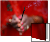 A Devotee Holds an Incense Stick as an Offering to the Setting Sun During the -Chhat- Festival