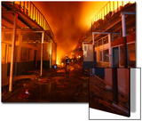 Firefighter Is Pictured Inside Burning Electronics Warehouse Belonging to Chaudhary Group