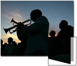 New Orleans Residents Play Trumpet During a Candlelight Ceremony