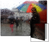 A Man Carrying an Umbrella Walks Through the Rain  as Seen Through a Window  in Kathmandu